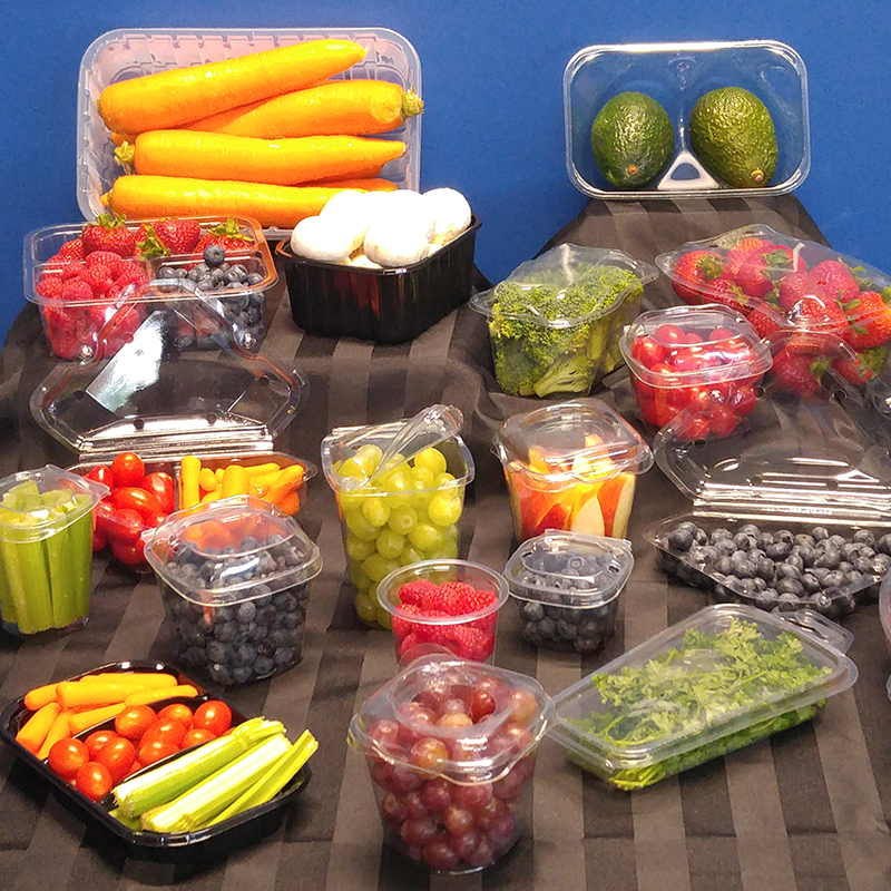 variety of snack and convenience packaging filled with fresh fruit on blue and black background