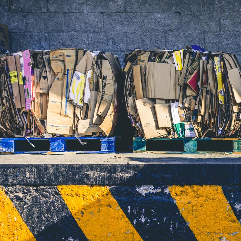 bundles of recycled cardboard on loading dock