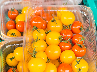 yellow and orange cherry tomatoes in top seal packaging tray