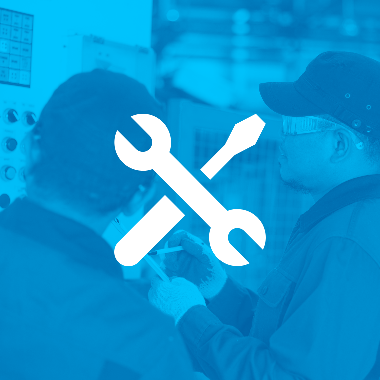 two men working on machine with blue overlay and white wrench icon