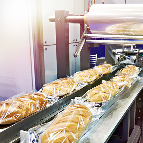 flow wrapped loafs of bread on flow wrapping machine
