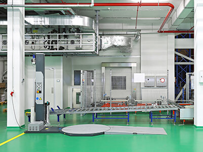 turntable stretch wrapper on green manufacturing floor
