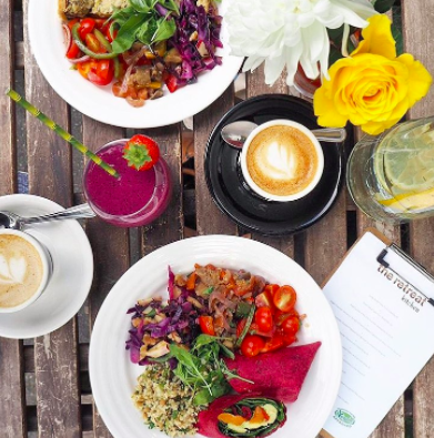 Vegan galore with fresh salad plates, Old Spike Roastery Coffee & fruit smoothies