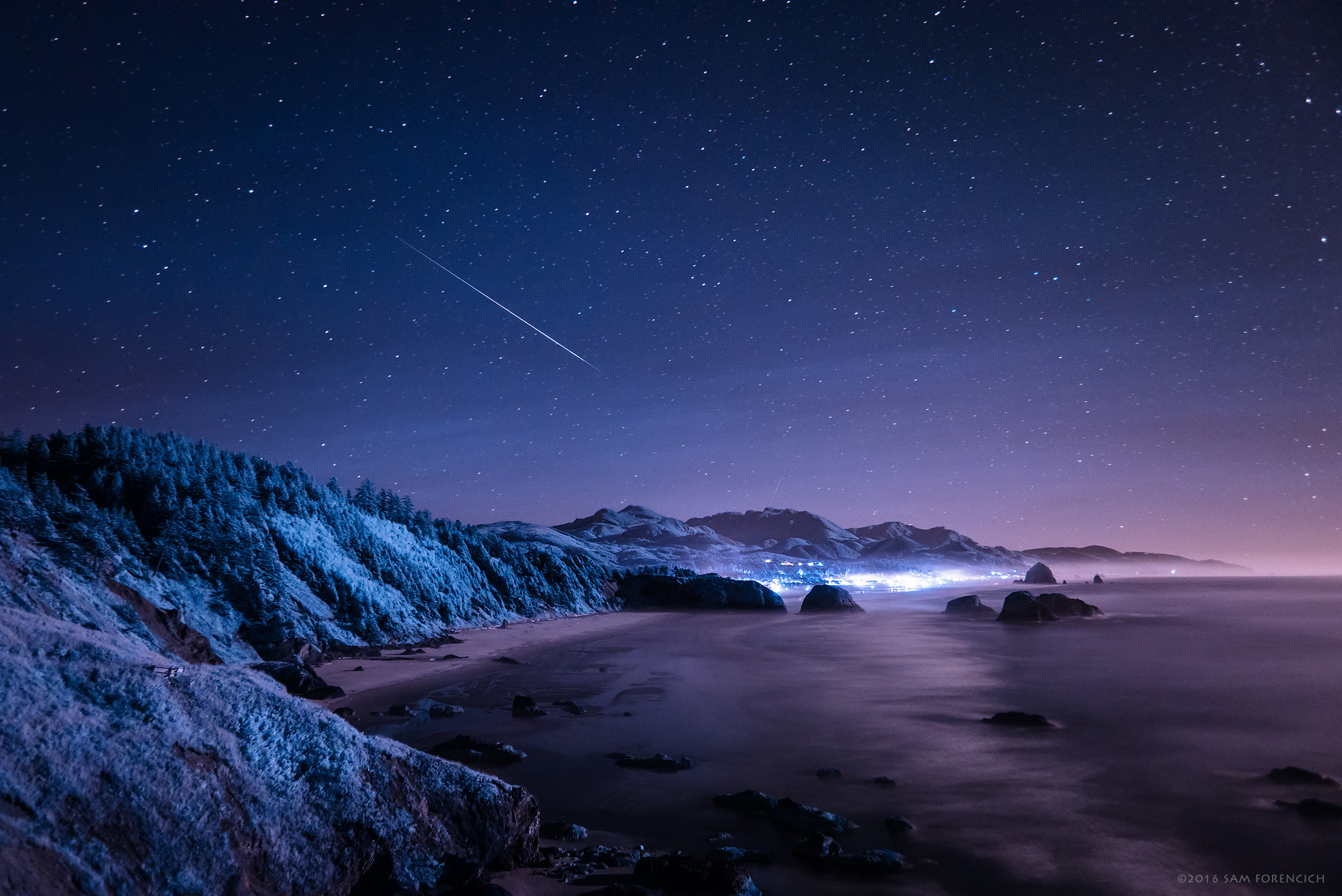 A meteor streaks through the atmosphere over Cannon Beach, Oregon during the peak of the Perseid meteor shower of 2016. Still image from Invisible Oregon time-lapse sequence. IR converted Nikon D750. © 2016 Sam Forencich