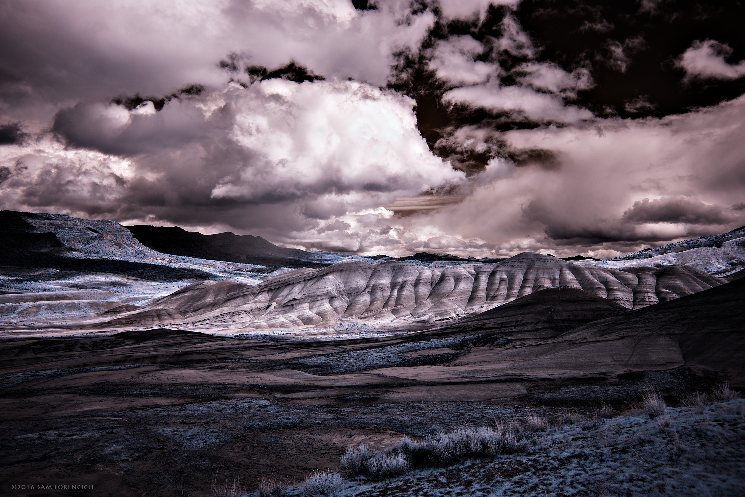 Storm clouds pass over the Painted Hills area of the John Day Fossil Bed National Monument in Central Oregon. Still image from Invisible Oregon time-lapse sequence. IR converted Nikon D750. © 2016 Sam Forencich