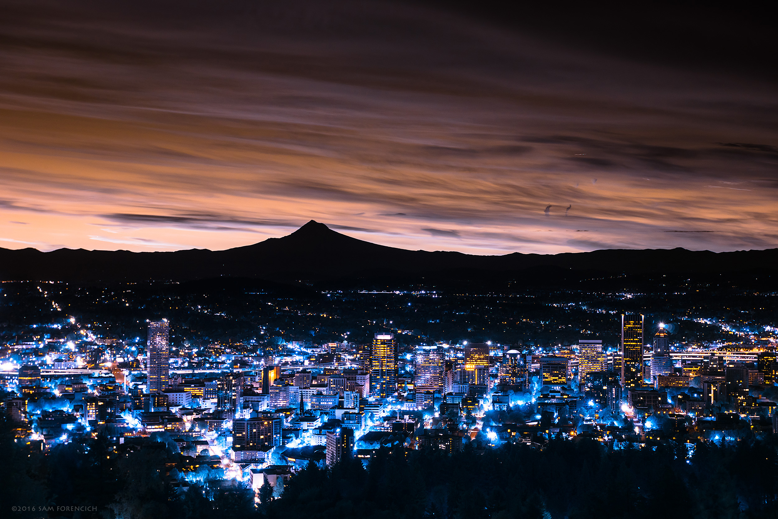 Downtown Portland, Oregon wakes up to the dramatic silhouette of Mt. Hood at sunrise. Still image from Invisible Oregon time-lapse sequence. IR converted Nikon D750. © 2016 Sam Forencich