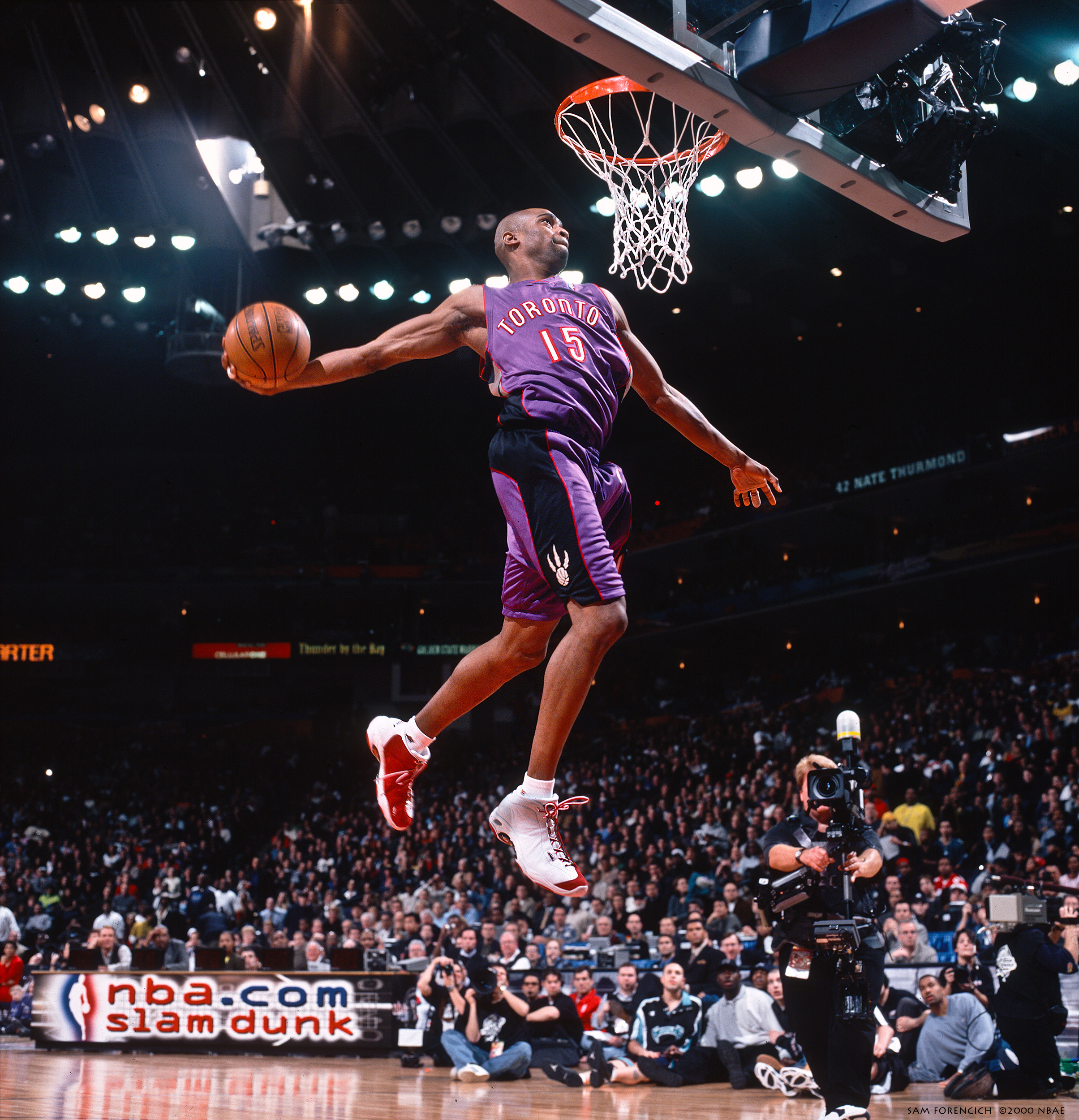 Oakland, CA - Vince Carter #15 of the Toronto Raptors goes for a dunk during the 2000 NBA All-Star Slam Dunk Contest at The Oakland Coliseum Arena on February 12, 2000. Manually focused Hasselblad, RDP 100 film, arena strobe lighting.  Sam Forencich ©2000 NBAE