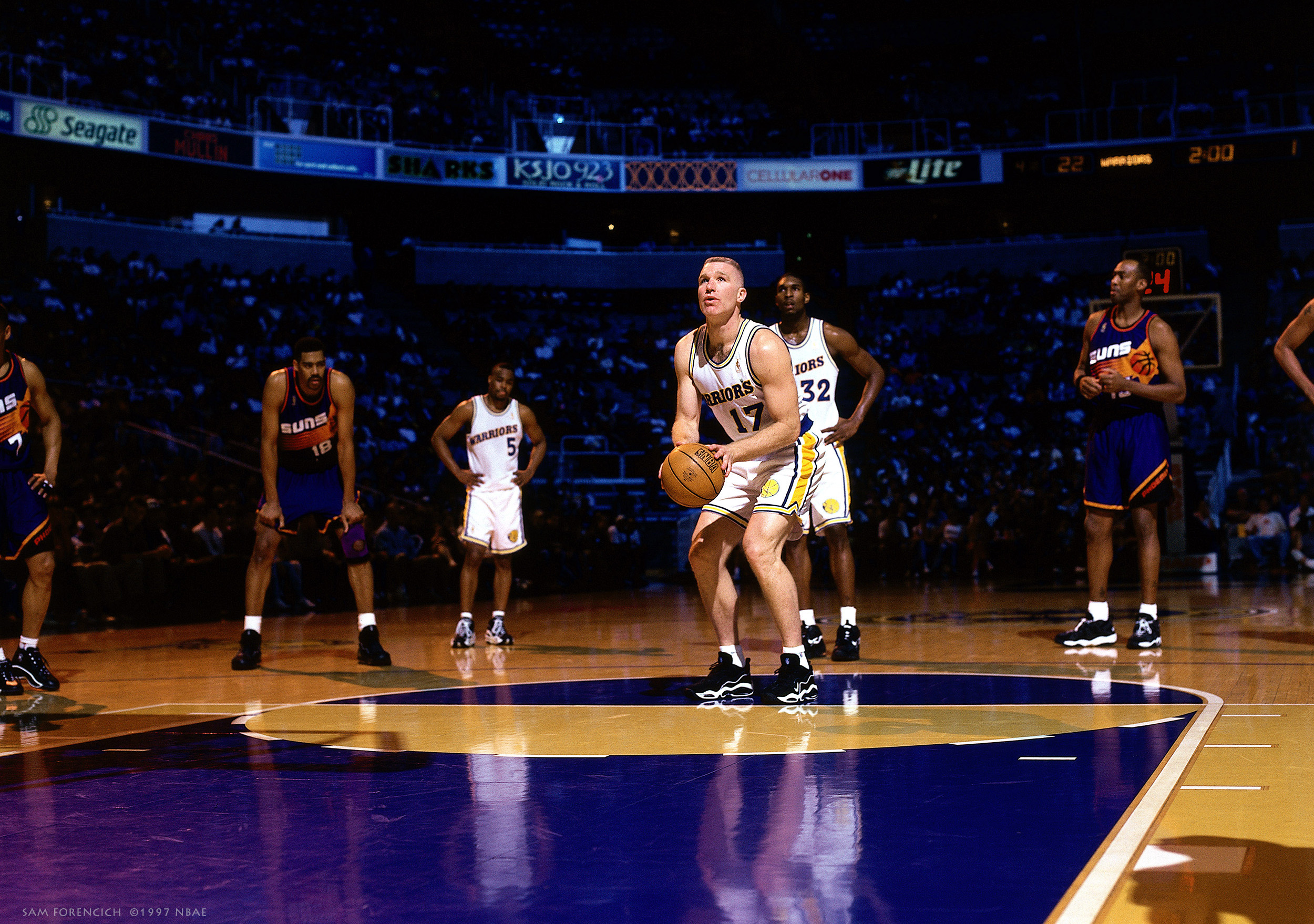 San Jose, CA - Chris Mullin #17 of the Golden State Warriors shoots a foul shot during a 1997 NBA game against the Phoenix Suns at the San Jose Arena. Manually focused Hasselblad, RDP 100 film, gelled arena strobe lighting.  Sam Forencich ©1997 NBAE