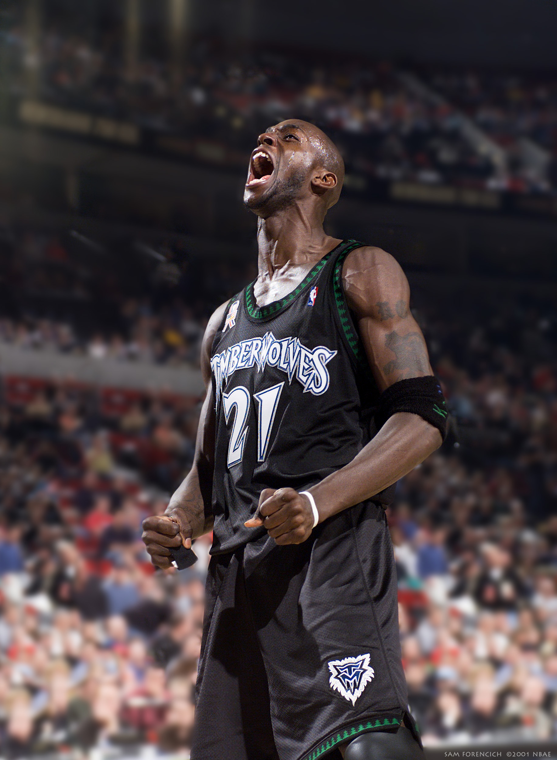 Portland, OR - Kevin Garnett #21 of the Minnesota Timberwolves reacts after a tough shot against the Portland Trail Blazers at the Rose Garden in Portland, Oregon. Digtal 35mm, arena strobe lighting.  Sam Forencich ©2001 NBAE