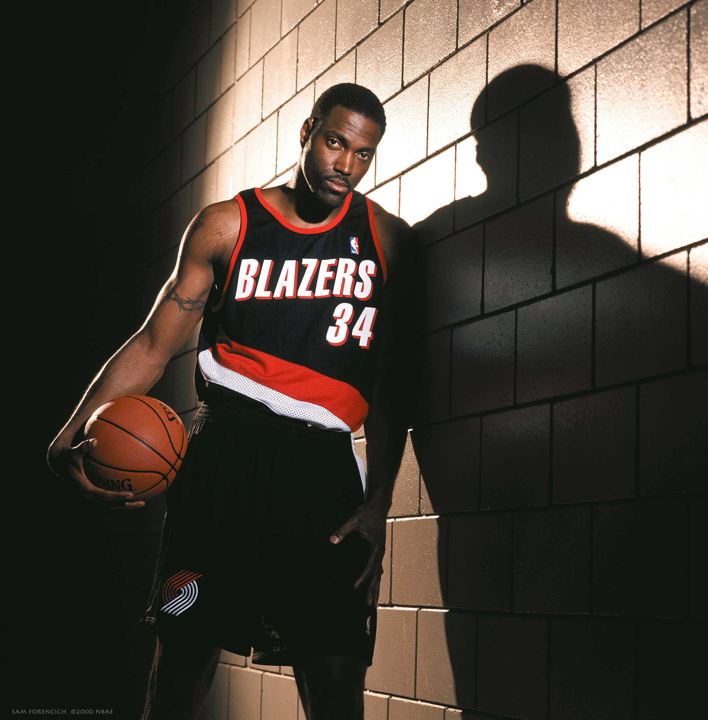 Portland, OR – Dale Davis #34 of the Portland Trail Blazers poses for a portrait at the Rose Garden Arena circa September 2000. This was his first time in a Blazer uniform after being acquired in a trade with the Indiana Pacers. Manually focused Hasselblad, RDP 100 film, studio lighting.  Sam Forencich ©2000 NBAE
