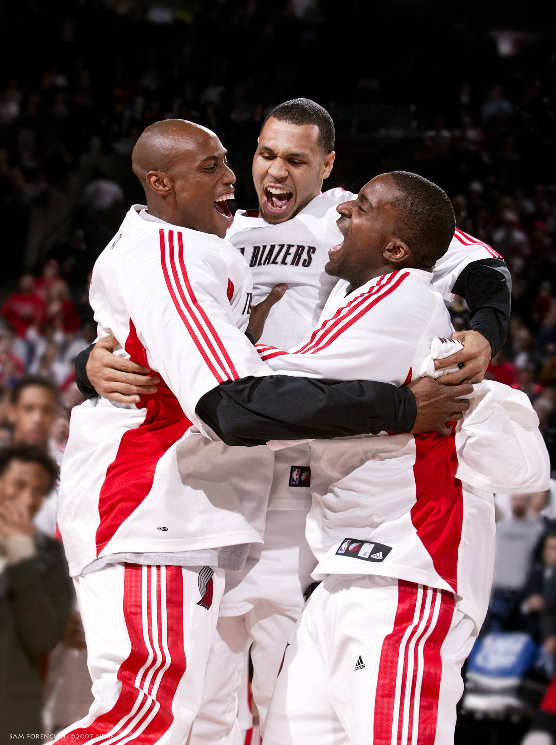 Portland, OR - Travis Outlaw #25 , Brandon Roy #7 and Martell Webster #8 of the Portland Trail Blazers get pumped before a game against the Seattle SuperSonics during a game on December 25, 2007 at the Rose Garden Arena. Digital 35mm, arena strobe lighting.  Sam Forencich ©2007 NBAE