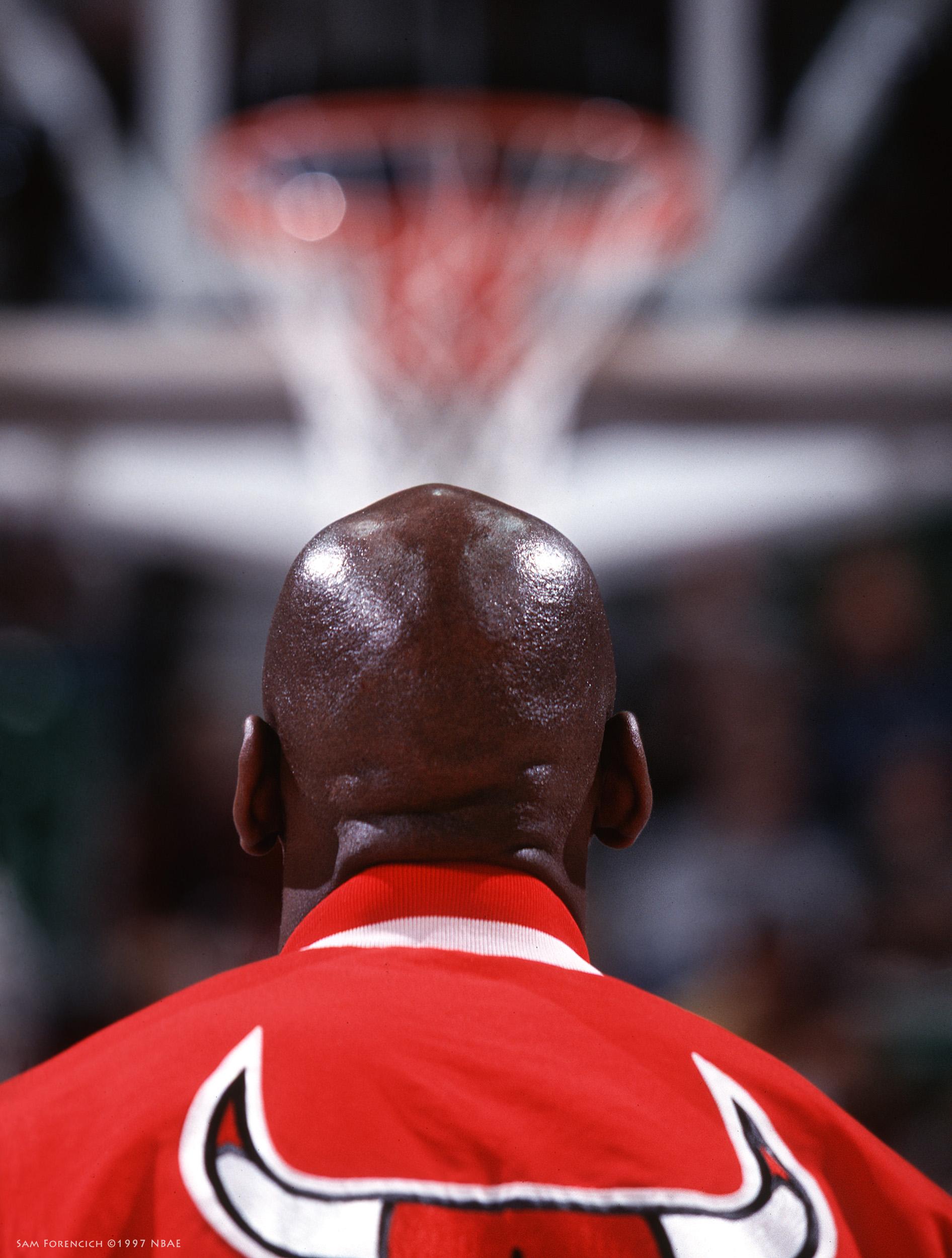 San Jose, CA - Michael Jordan of the Chicago Bulls eyes the basket during warm ups at the San Jose Arena circa 1997. 35 mm RDP 100 film, arena strobe lighting. Sam Forencich ©1997 NBAE