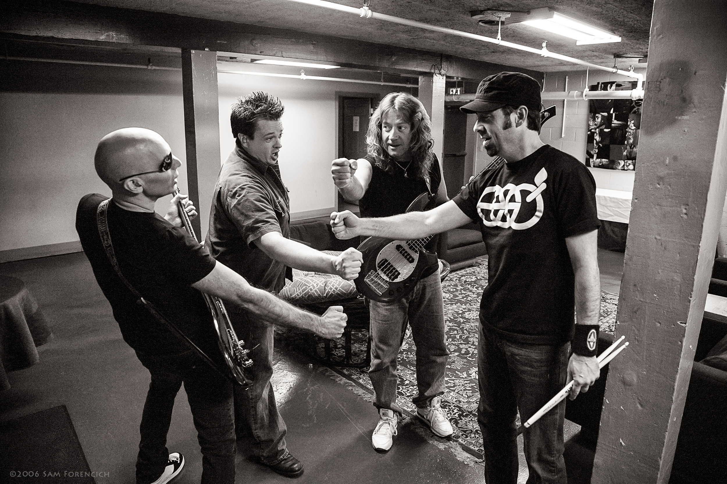 May 2006,Portland, Oregon - Joe Satriani, Galen Henson, Dave LaRue, and Jeff Campitelli share a moment prior to their performance at the Roseland Theater - 2006 Super Colossal Tour ©2006 Sam Forencich