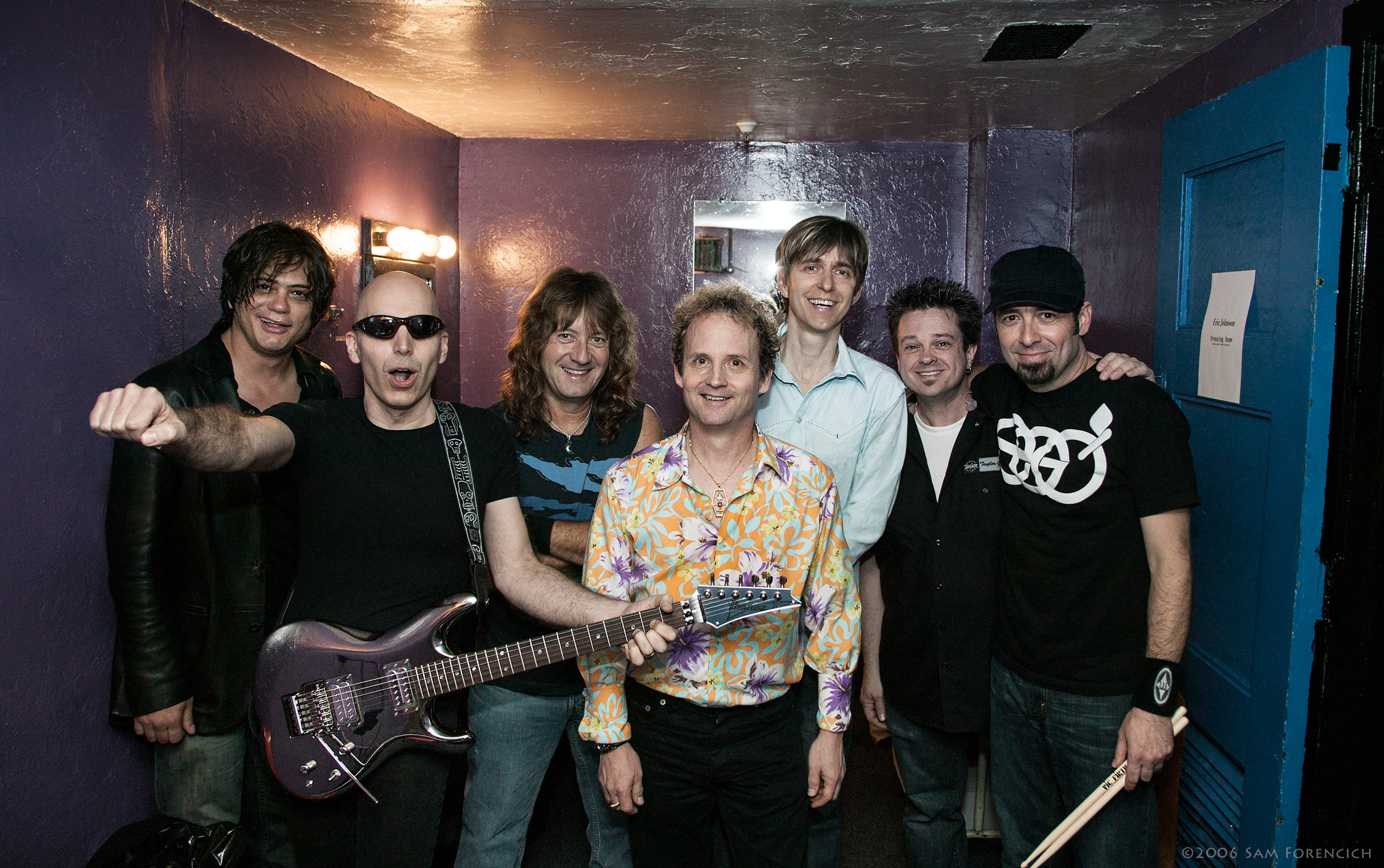 May 2006,San Francisco, California - The Joe Satriani and Eric Johnson bands gather for an end of tour photo backstage at the Warfield Theater - 2006 Super Colossal Tour ©2006 Sam Forencich