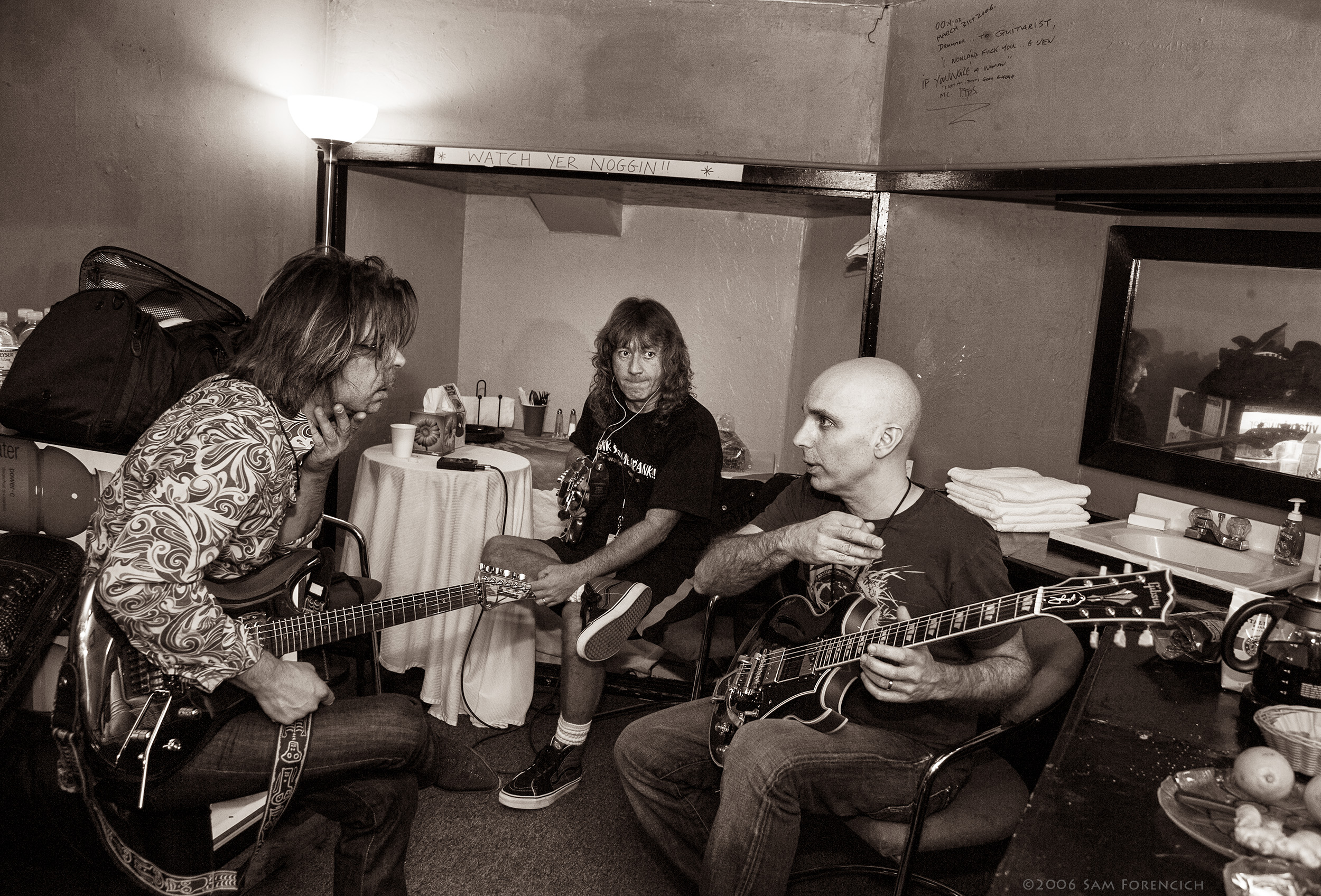 May 2006,San Francisco, California - Joe Satriani,guest Jonny A. and bassist Dave LaRue discuss their upcoming performance backstage at the Warfield Theater - 2006 Super Colossal Tour ©2006 Sam Forencich