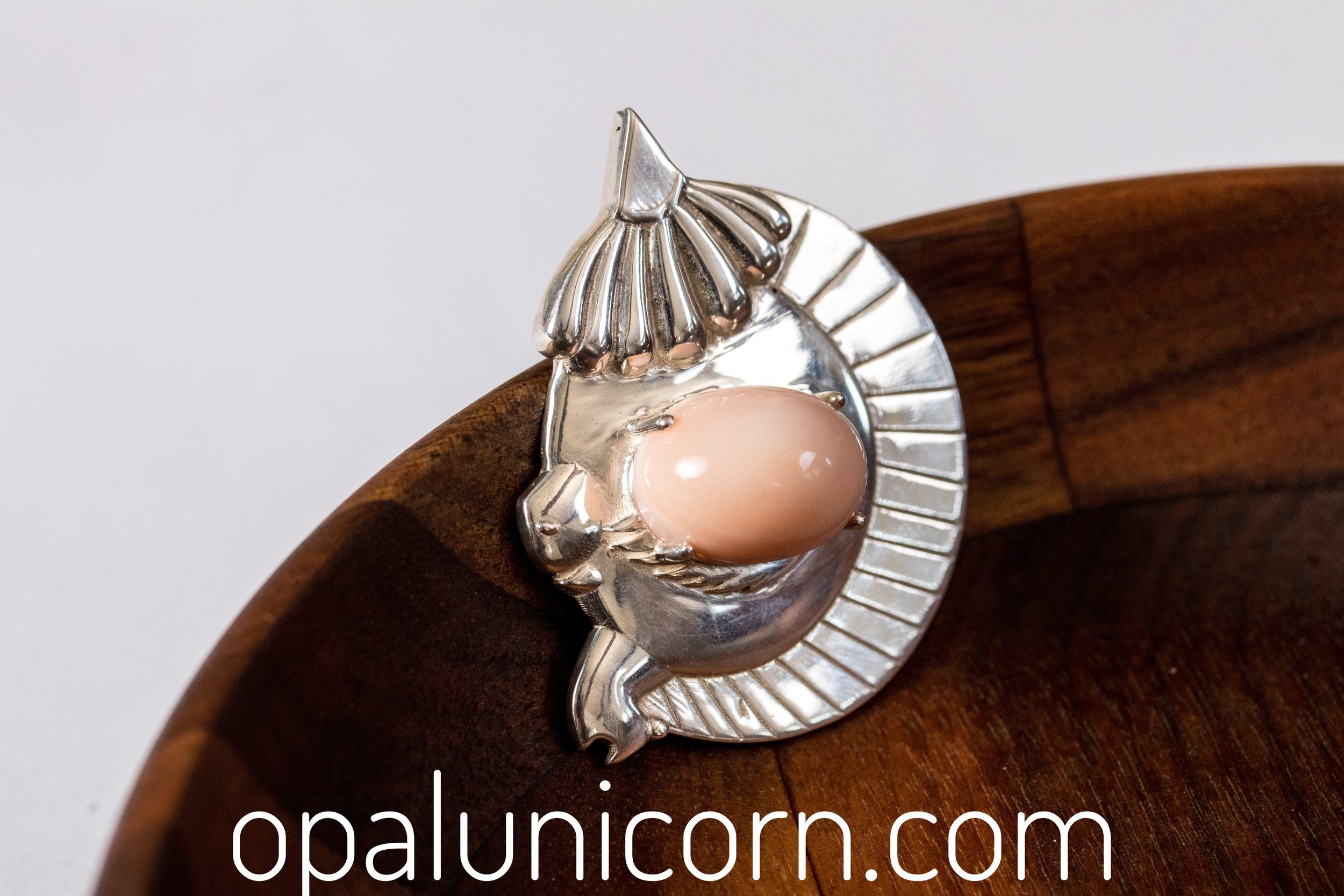 sterling silver large size with big eye in pink Peruvian opals.