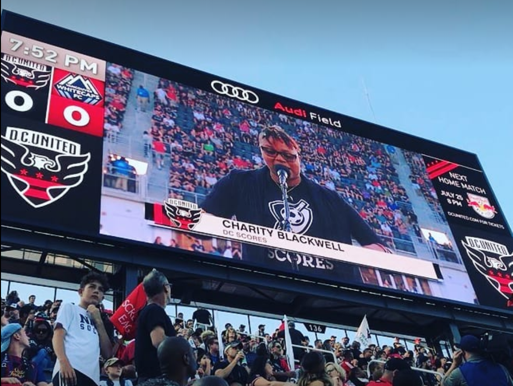 Charity Blackwell performs an  original poem  before kick-off at Audi Field's opening match.