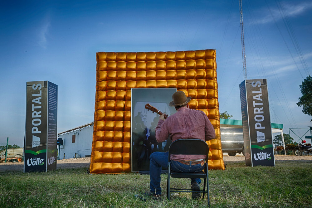 A musician at the inflatable Portal in Veracruz, Mexico, performing live for an audience at the portal in Mexico City.
