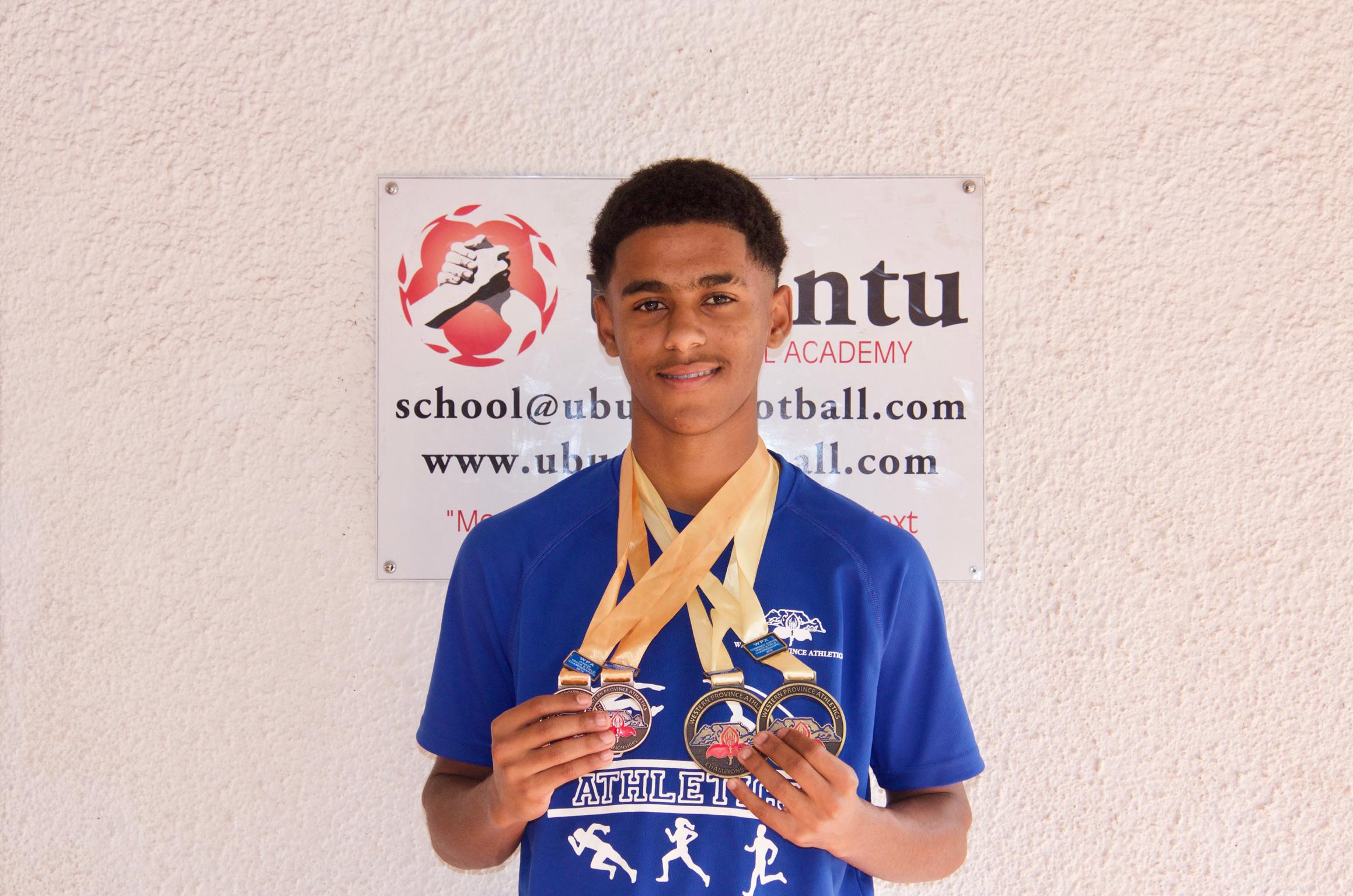 Duwayne holding his decathlon medals.
