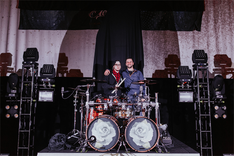 Roadie for a Day Contest winner Bobby Laflamme and August Burns Red drummer Matt Greiner hanging out on-stage during sound check.