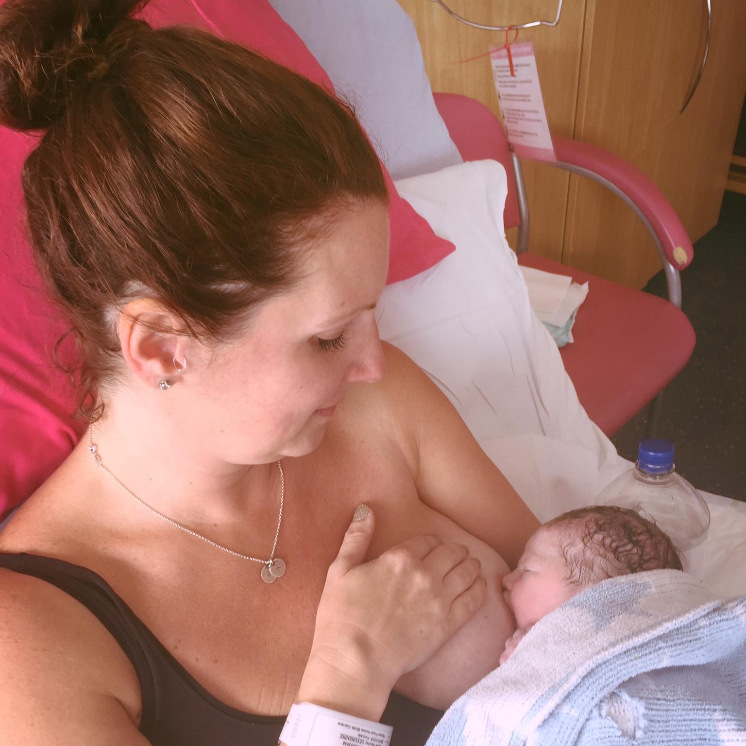Tessa breastfeeding Dolly