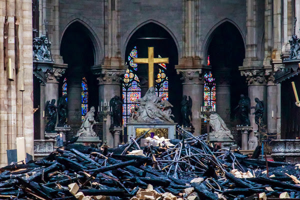 "The 1725 Pietà statue, ""Descent from the Cross,' surrounded by rubble after the fire at Notre Dame."