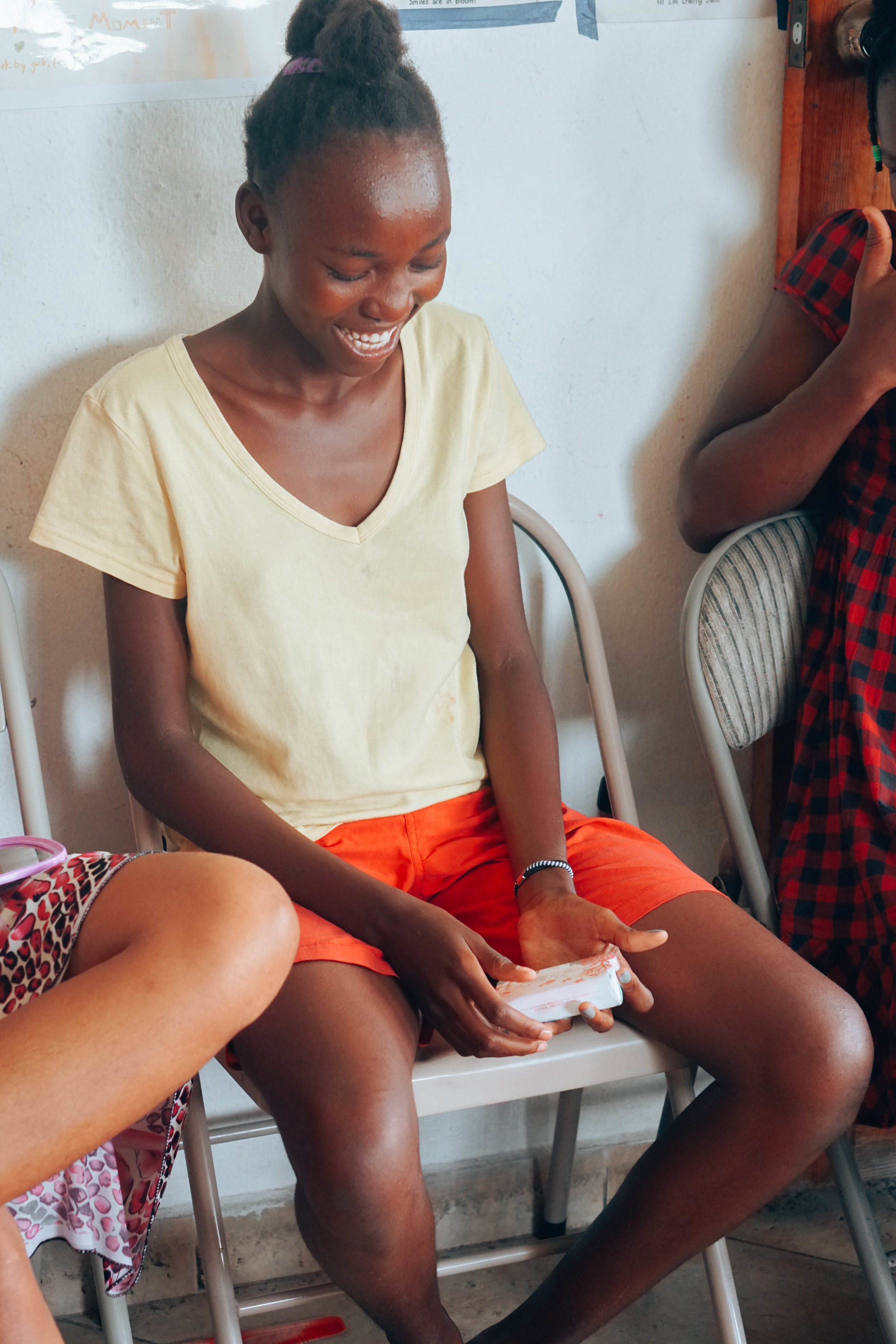 A young woman from Reveil Matinal Orphanage admires her illustrated bar soap wrapper. Image: Jen Morilla