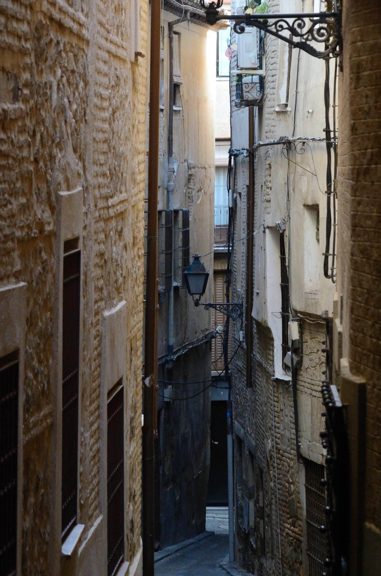 Narrow street in historical part of Toledo, Spain
