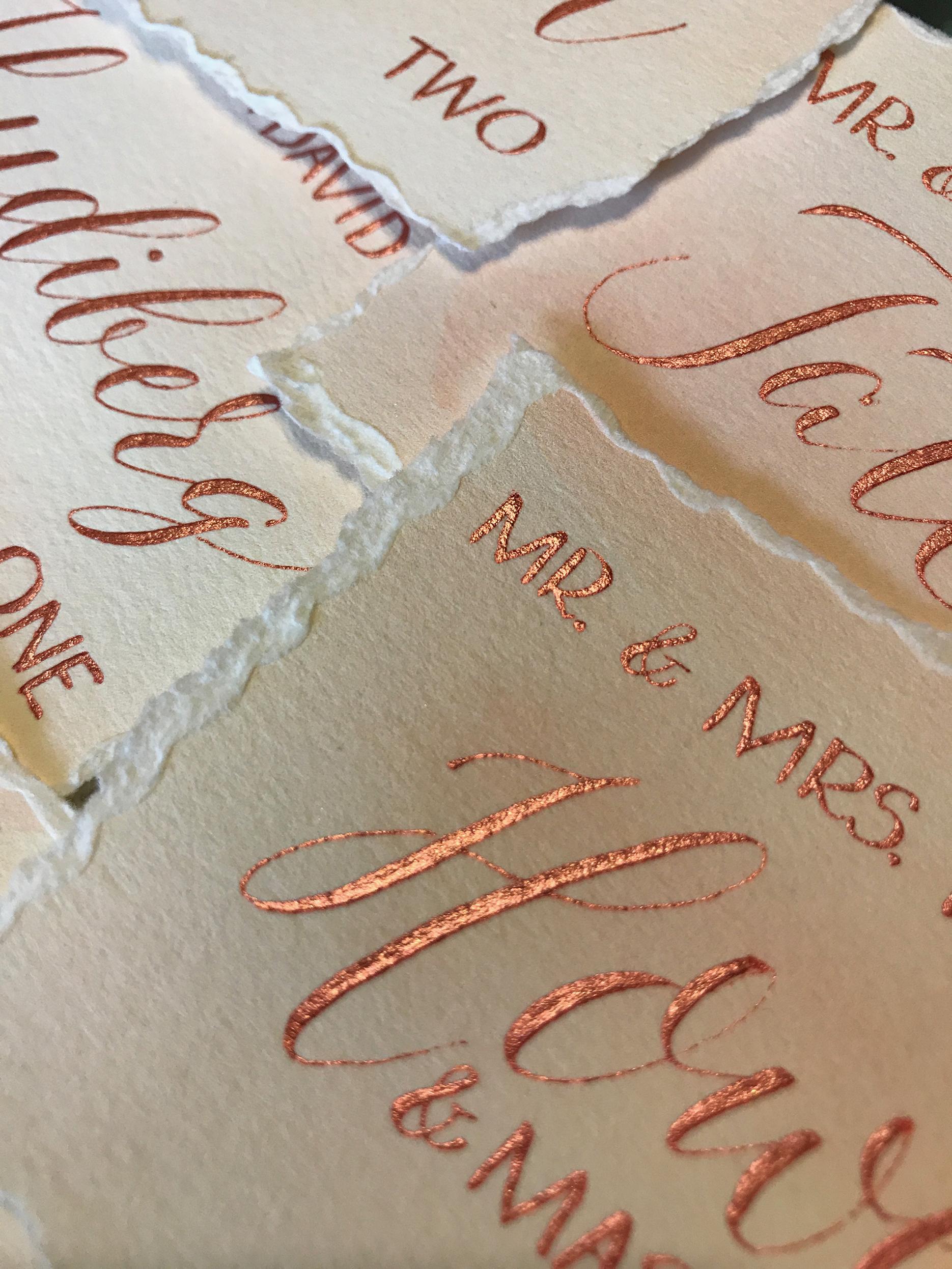 Rose gold calligraphy escort card.jpg