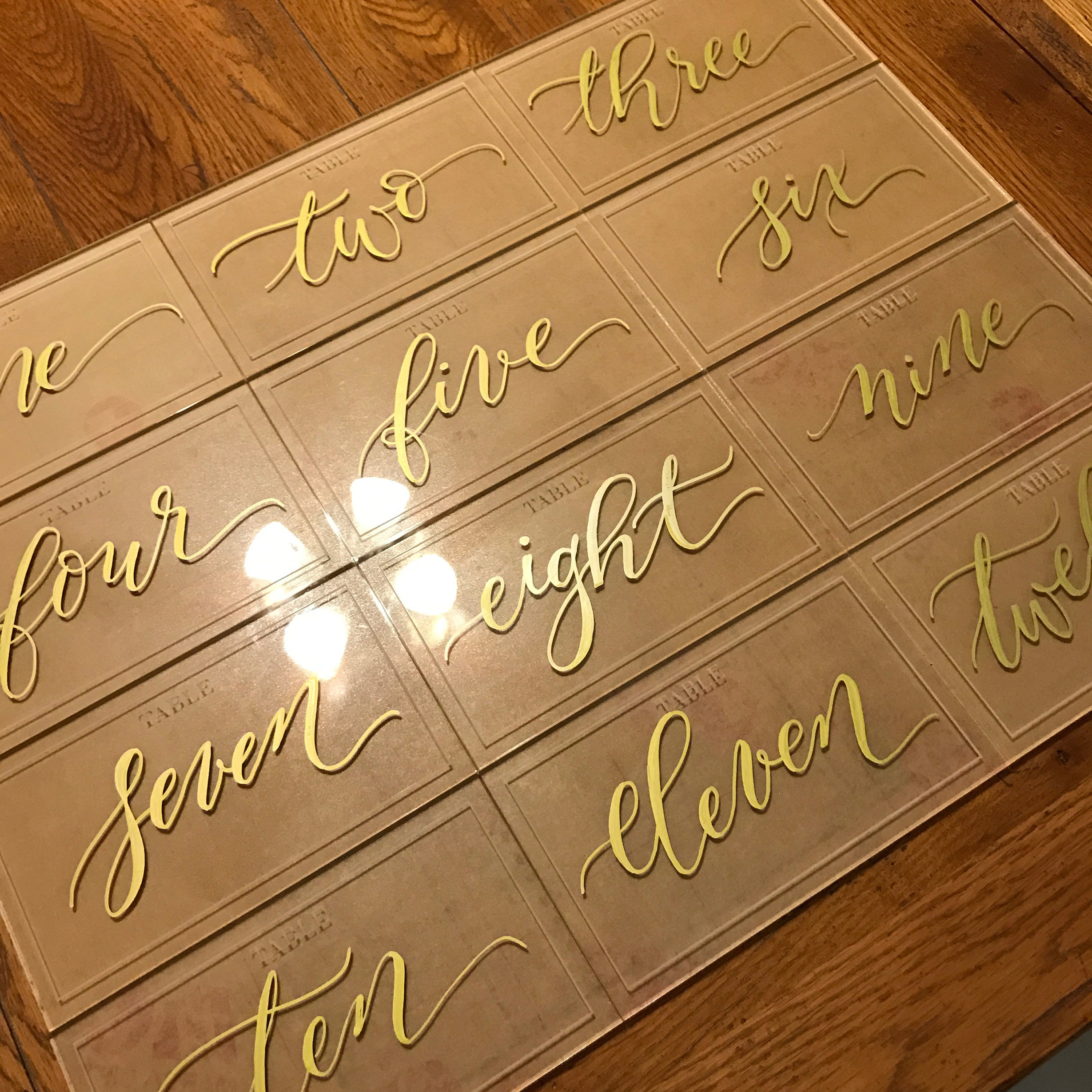 Gold Calligraphy on acrylic table numbers.jpg