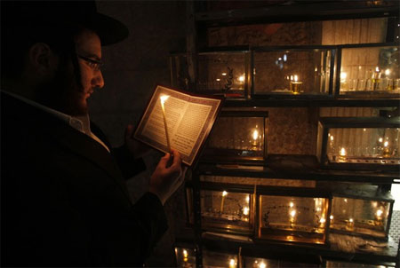 Many Orthodox Jewish families have the custom of lighting the menorah and storing it in a glass box on the street.