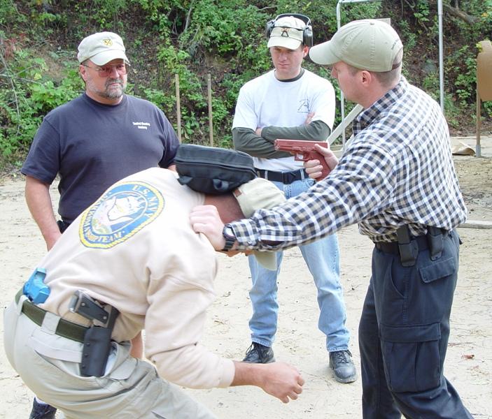 D.R., Kevin Apland & Rick Simes Studying Handgun Strikes with Paul Sharp of Sharp Defense