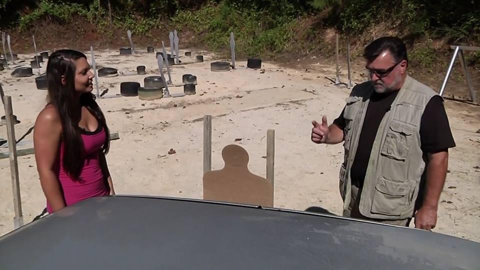 D.R. & Ashley Examine Bullet Holes in Car.jpg