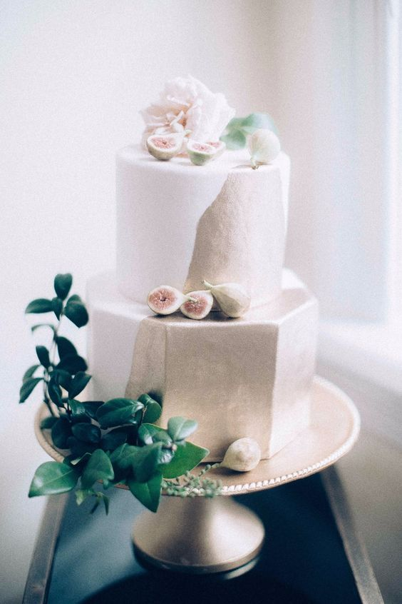 I absolutely love the geometric cake with the gold and fruit. So pretty!   Photo:  http://www.weddingchicks.com