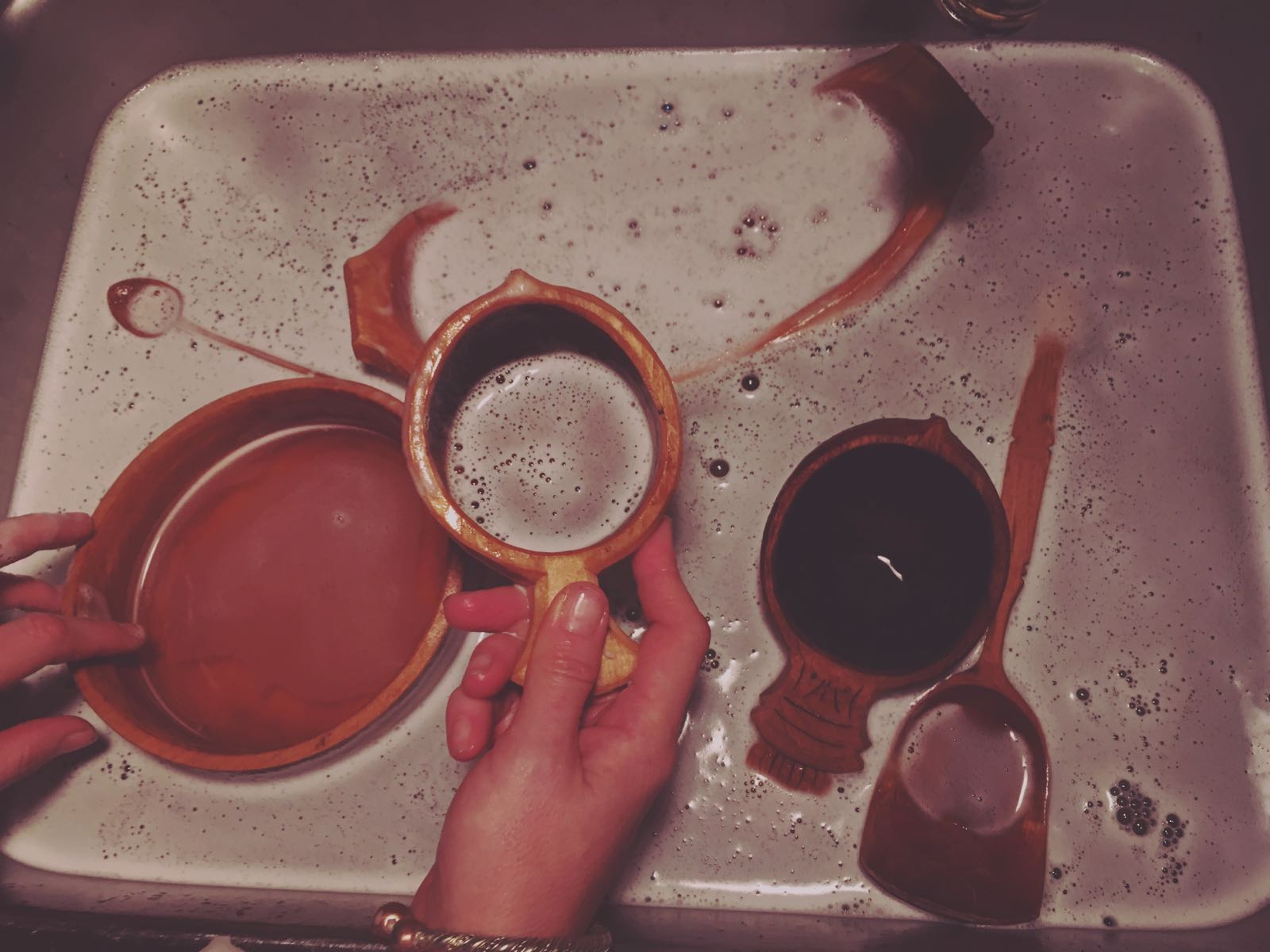 Warm soapy water for cleaning handmade wooden items