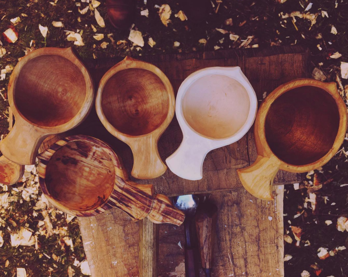 Freshly carved White Birch Kuksa (second from right) next to a 6 month old Kuksa (far right) -well loved with daily morning coffee.