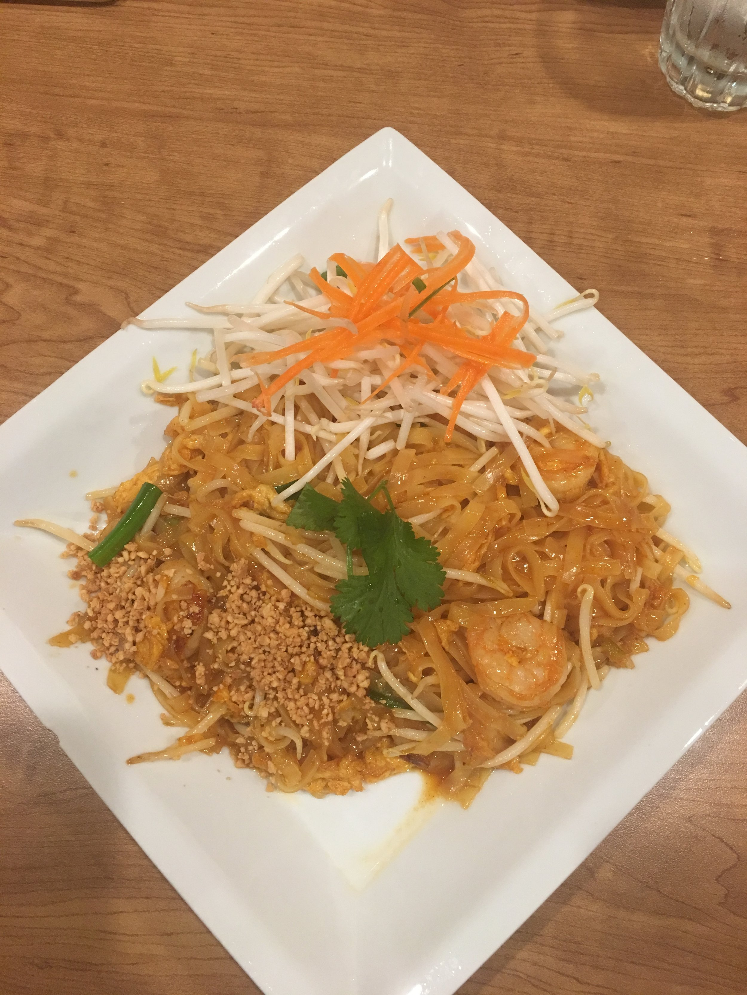Pad Thai : Pan-fried rice noodles with egg, green onions, bean sprouts, crushed peanuts, in special sauce, with Shrimp
