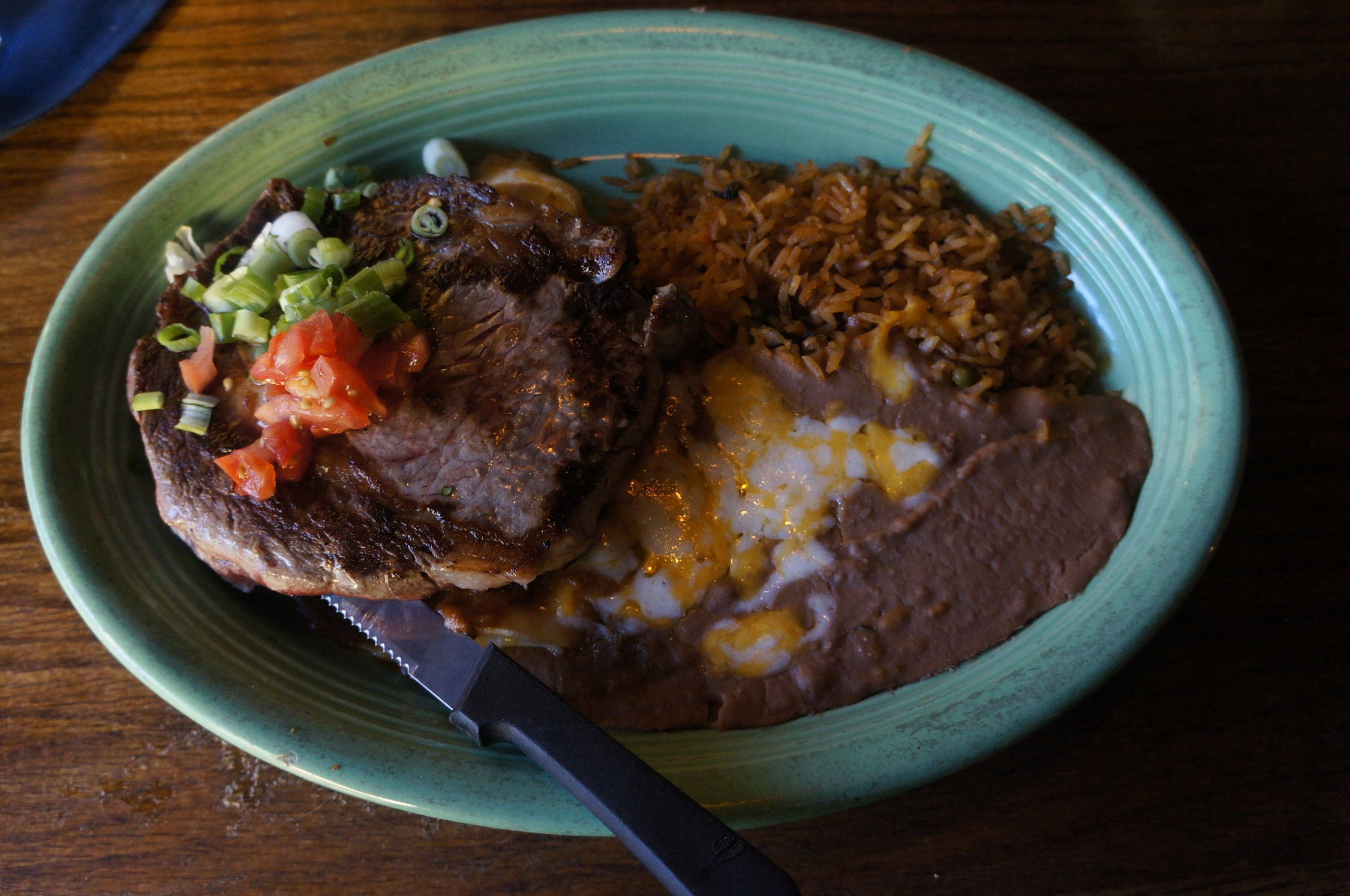 Carne Asada :   A tender ribeye steak, mesquite grilled to perfection. served with a cheese enchilada, rice and beans