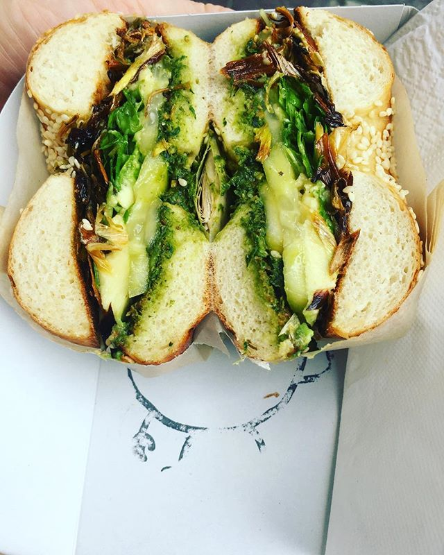 Get THE GREENS 🥬 🥑 🥒 🚀 🍀  This bagel hasn't been around long but it's already a favourite here.  House made pesto, avocado, spicy pickled cucumber, grilled fennel & leek with wild rocket. All green. All vegan. All good.  #bagels #vegan #greens #breestreet #capetownfood #maxbagels