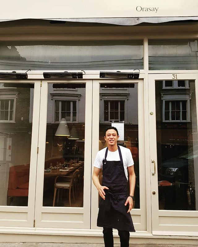 Max Bagels co-honcho, chef Andrew Kai, pictured here outside @orasay.london, the third of maestro @Jackson_boxer (and co)'s restaurants in the city which opened last week. Andrew is part of the kitchen team launching this magnificent eatery into the world, doing right by his desire to always keep learning. Bagel team misses you, but we love what you're doing - and we know you'll come back strong and with a hat full of ideas and new skills. All the best, chef!  #cheflife #orasay #bagelboss #london #andrewkai