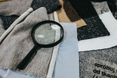 kaboompics_Magnifying glass with fabric on a table.jpg