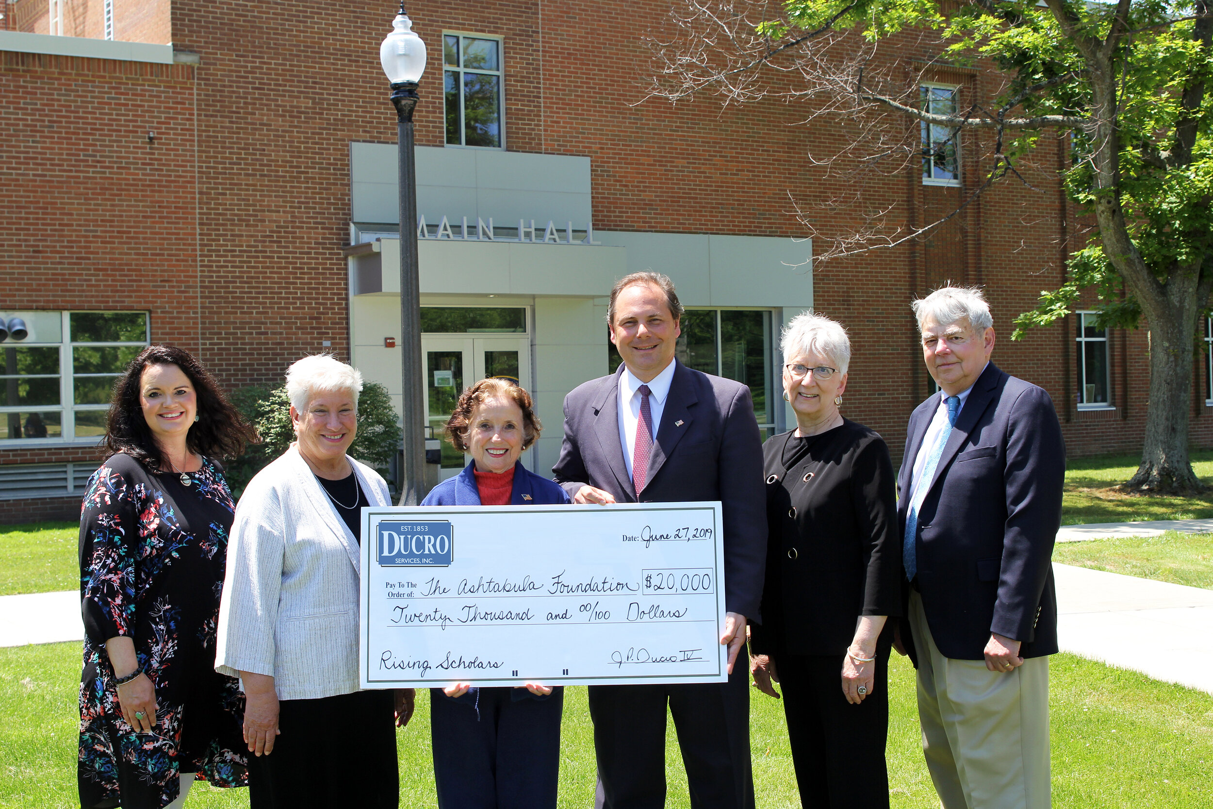 """The Ducro Family recently gave a $20,000 gift to the Ashtabula Foundation for the Kent State Ashtabula Rising Scholars Program Fund. Pictured are (left to right): Kent State Ashtabula Associate Lecturer of Theater and Rising Scholars Coordinator Natalie Huya; Dean and Chief Administrative Officer Dr. Susan J. Stocker; Sue Ducro; J.P. Ducro IV; Ashtabula Foundation Trustee and Past President Cheryle J. Chiaramonte, and Foundation Board Secretary/Treasurer William W. """"Bud"""" Hill."""