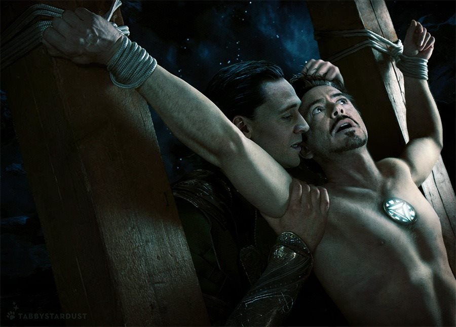 Tom Hiddleston crucifying Robert Downey Jr. playing out their respective Avengers roles