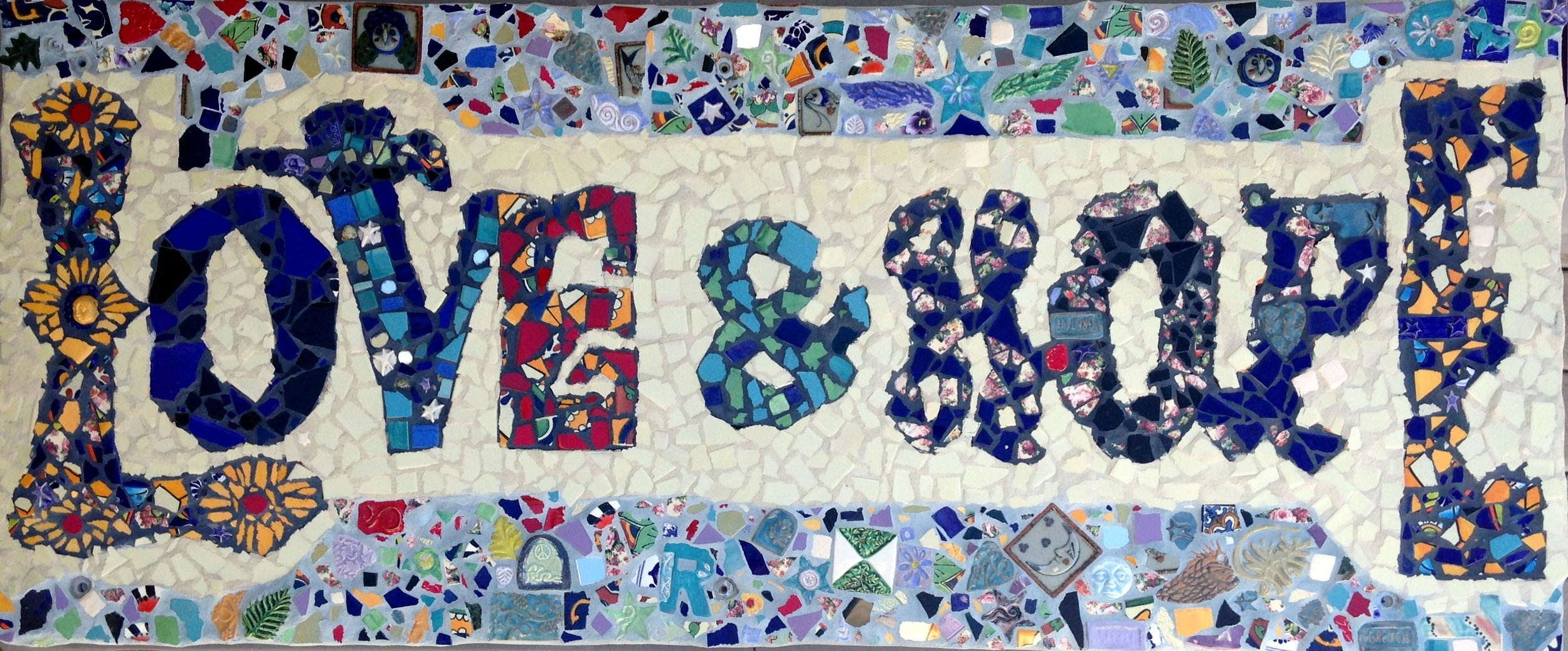 """LOVE AND HOPE"" mosaic, public art project created by Youth in Crisis at the Youth Shelter in Laguna Beach, CA. Funded by LOCA, Gretchen and Terry Shannon and Carla Meberg Facilitated by Gretchen Shannon and Carla Meberg."