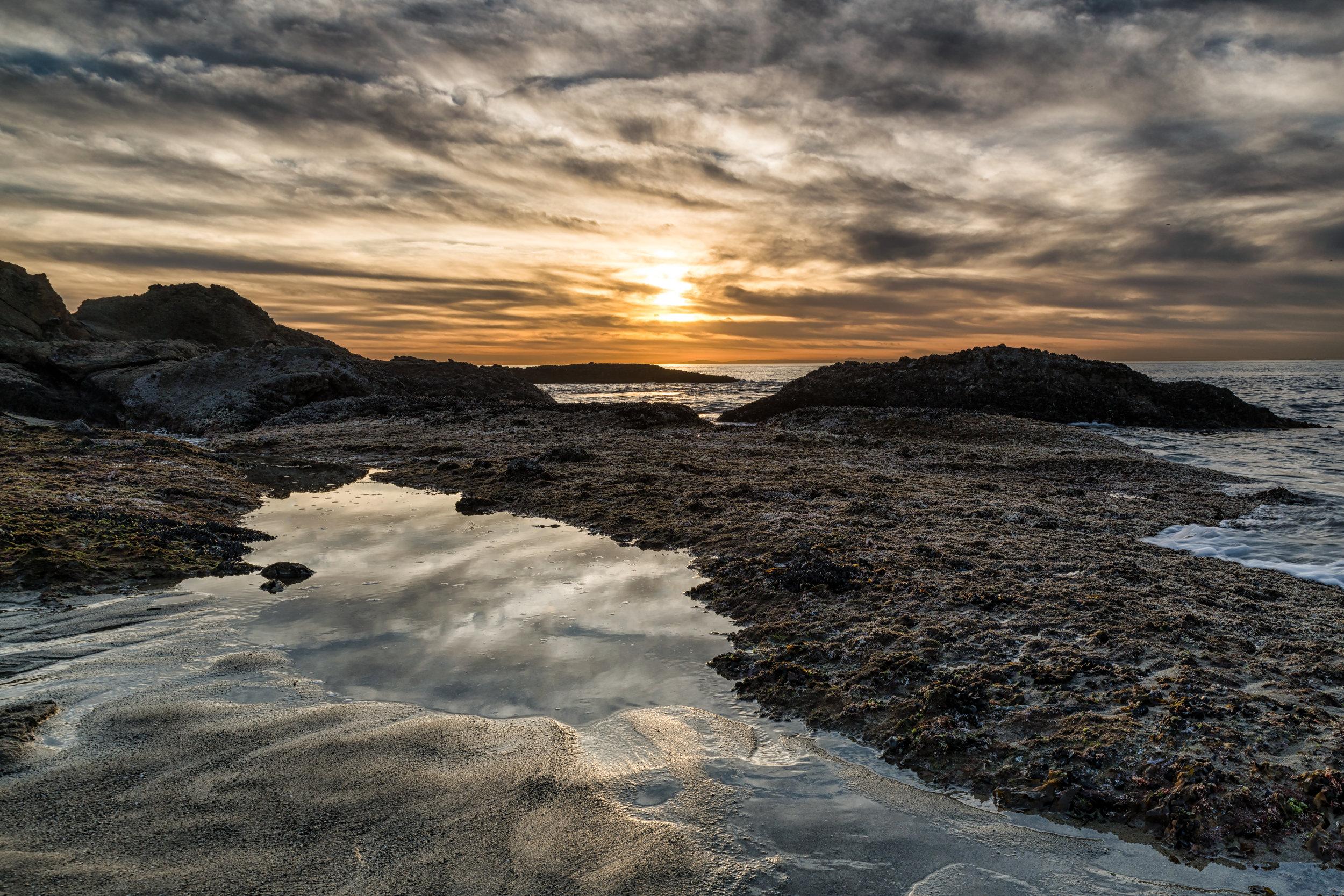 The tide rising at Laguna Beach during sunset.