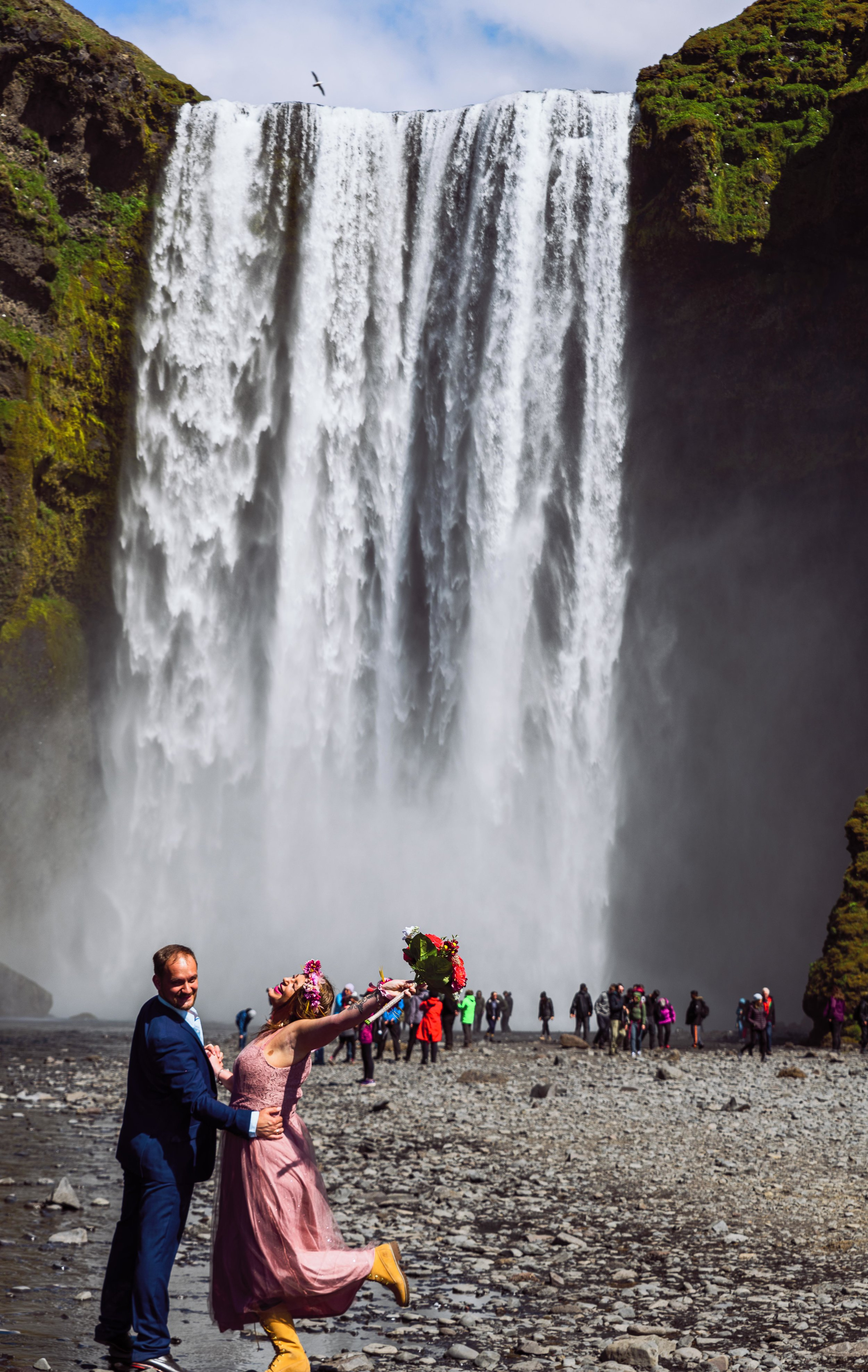 A couple enjoying their exciting day at Skogafoss