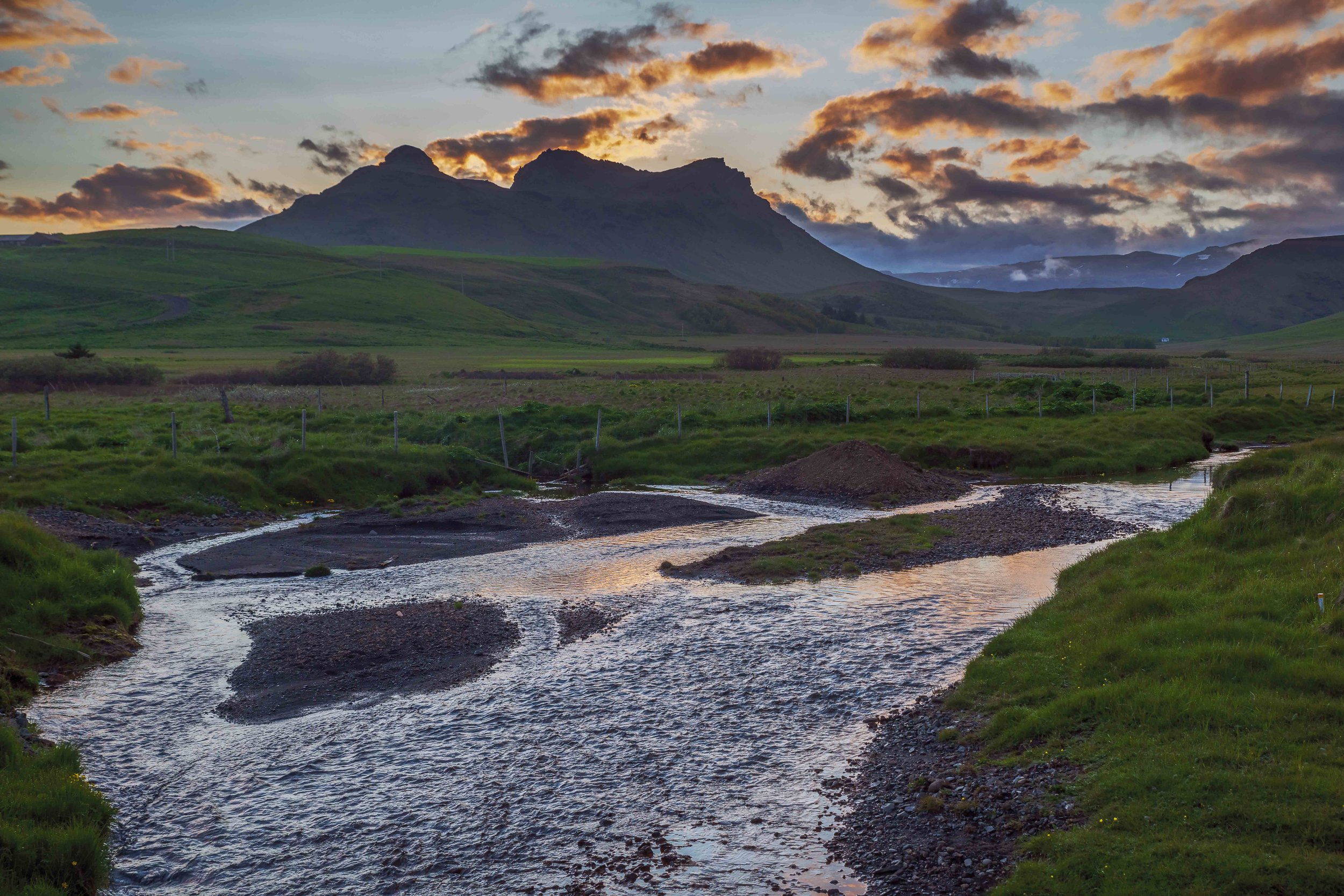 Sunset over a stream near Vik