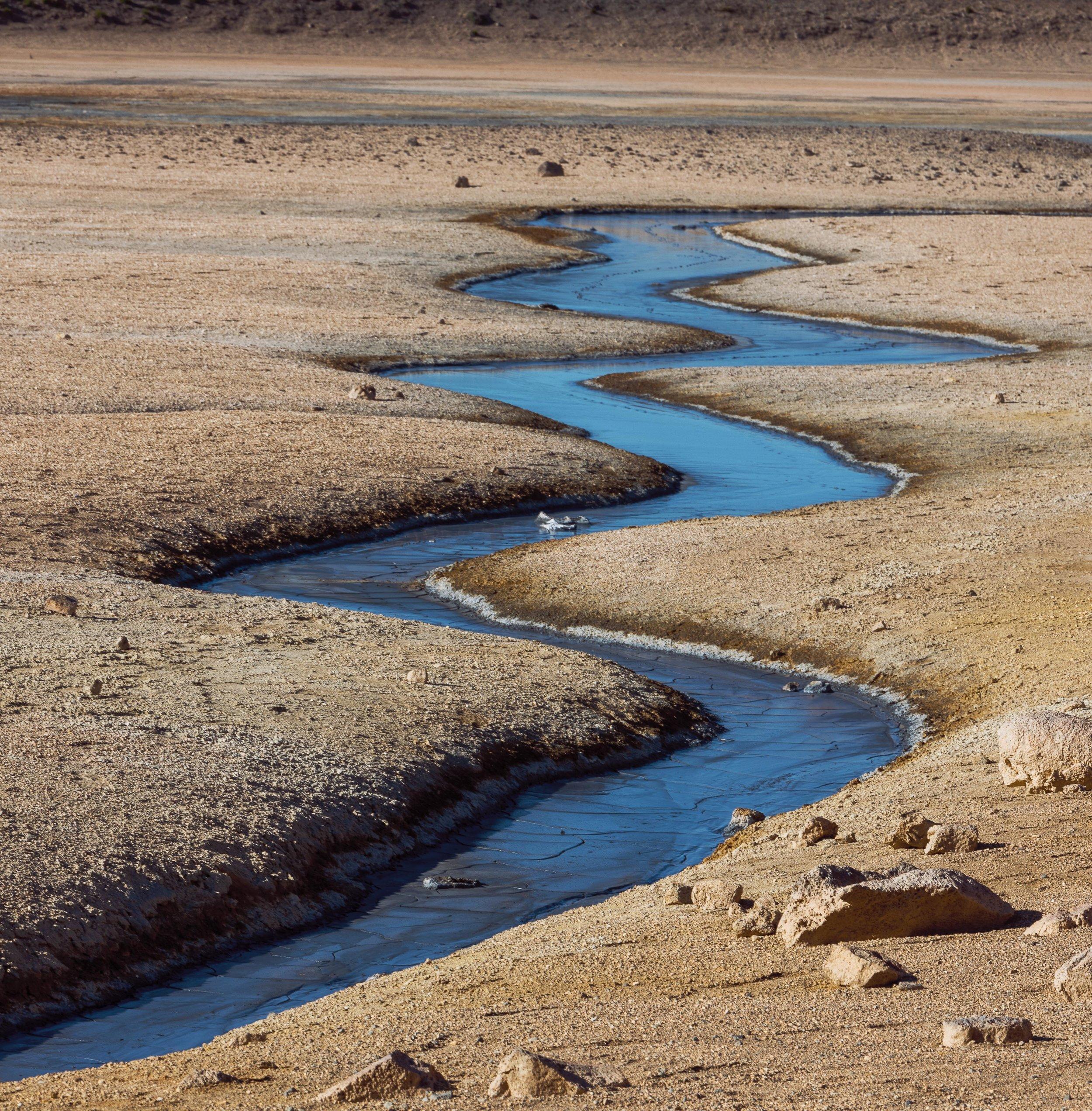 Curvy stream at Hverir Geothermal Park