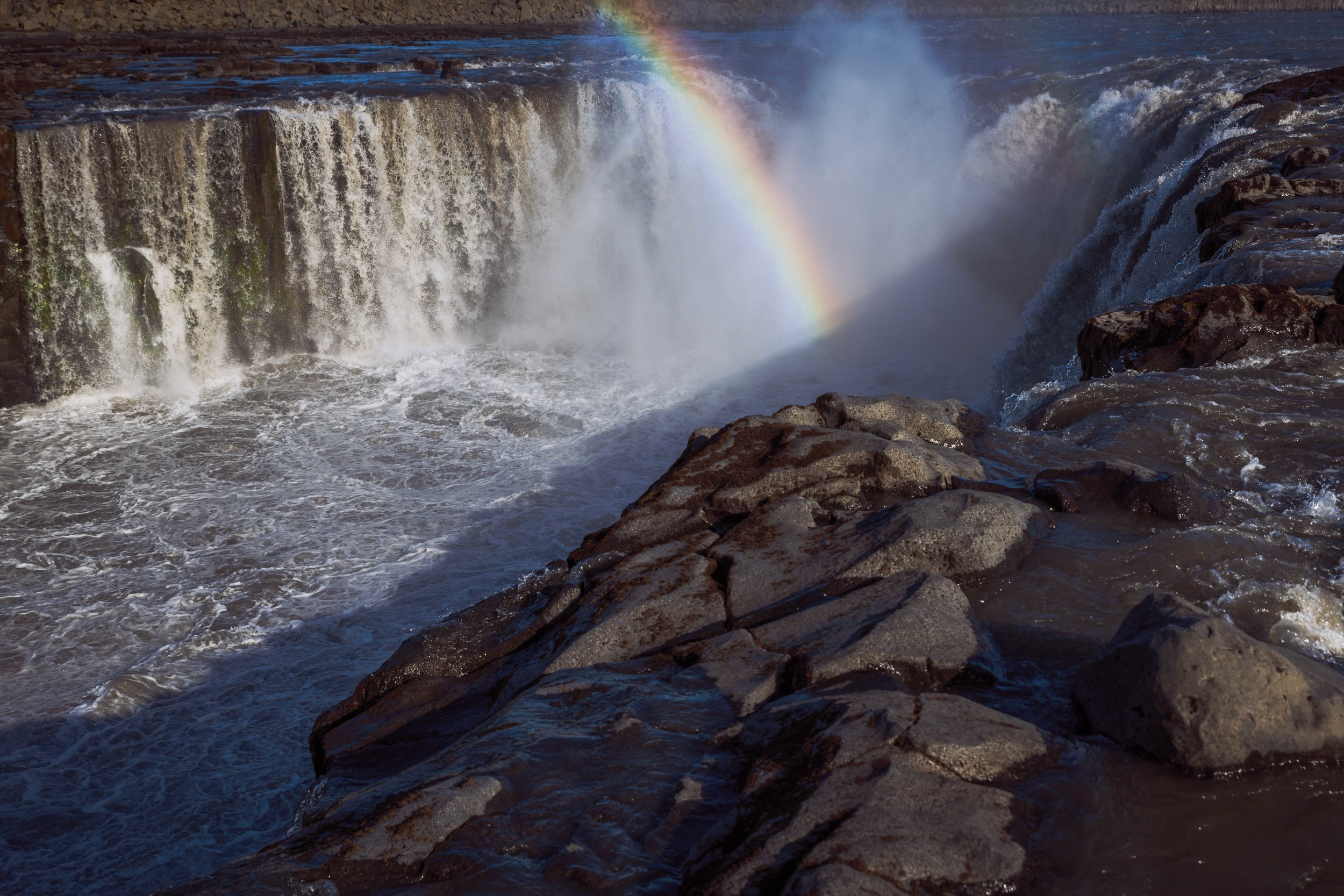A rainbow formed by the mist at Dettifoss