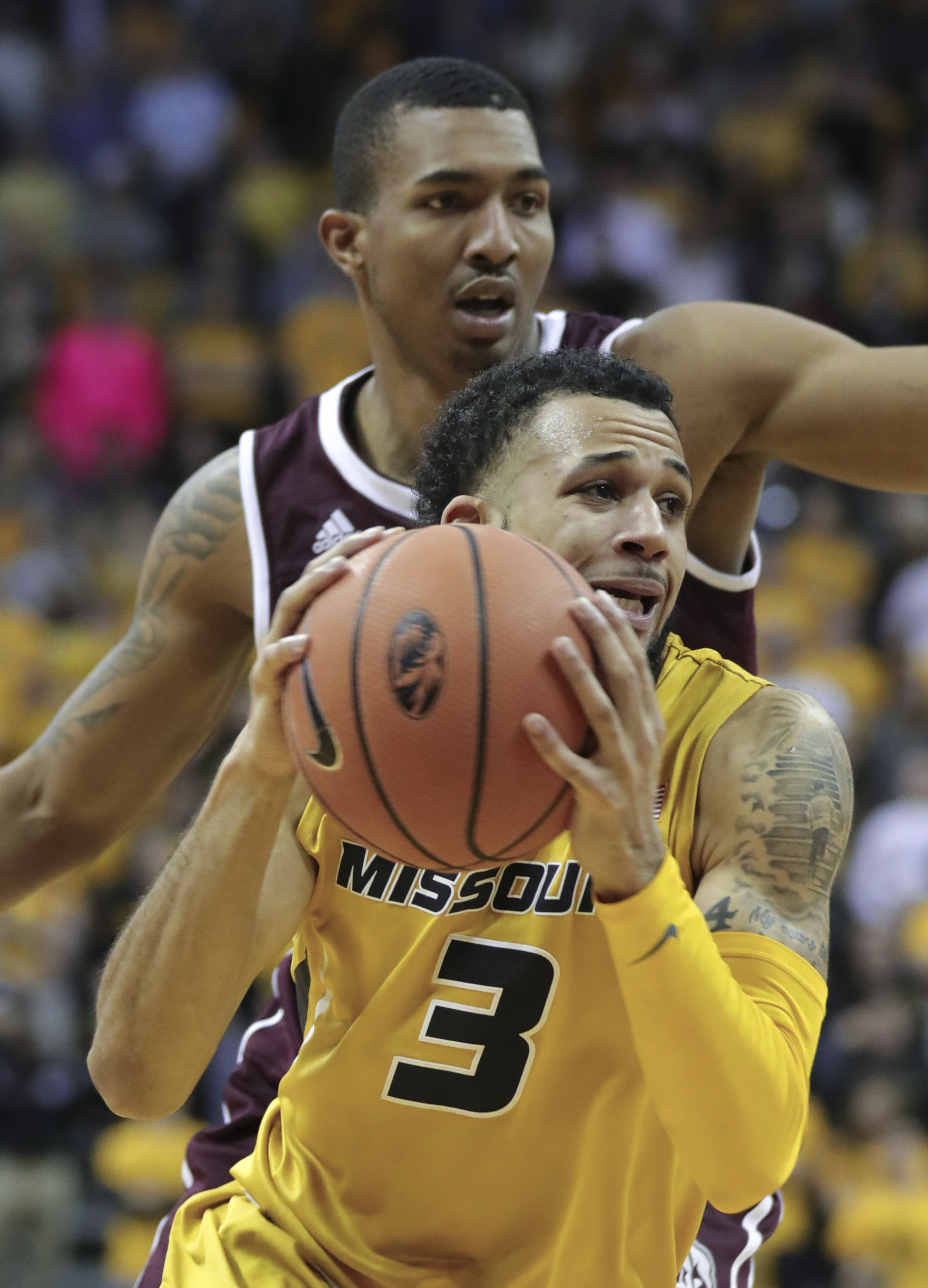 Kassius Robertson drives the ball while Xavian Stapleton chases during Missouri's 89-85 overtime victory over Mississippi State on Saturday, Feb. 10, 2018 at Mizzou Arena. Robertson scored a team-high 22 points.